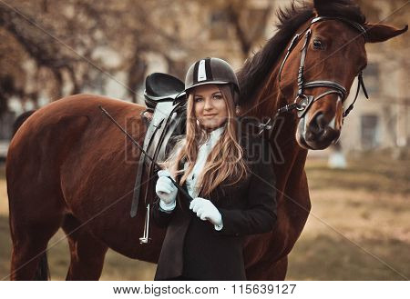 Emotional, happy, kind girl, lady,model with horse. Face, elegant. Closeup, amazing, activity, excellent long day in the horse park. Riding, standing near the mare in special uniform, woman with horse, happy, style
