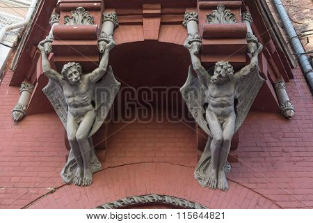 Kiev, Ukraine - September 14, 2015:  Sculptures demon with wings on wall of house