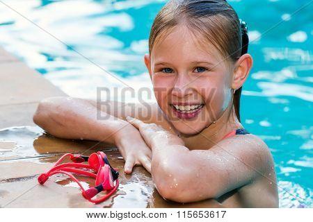 Portrait Of Cute Girl In Swimming Pool.