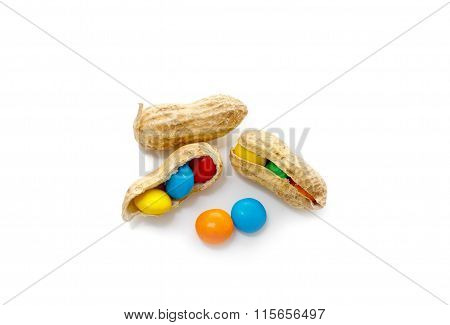 colorful candy dragees in peanut shell