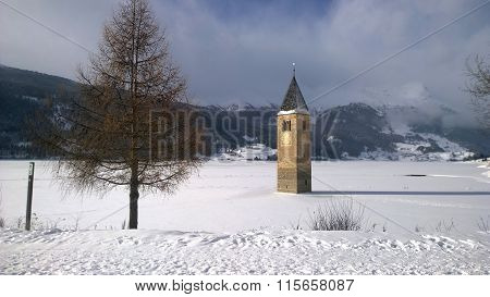 Bell tower immersed in a frozen lake