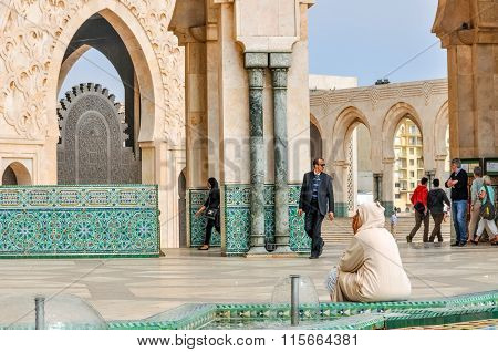 CASABLANCA, MOROCCO, APRIL 2, 2015: Local people gather on the outside grounds of Hassan II Mosque or Grande Mosquee Hassan II