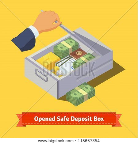 Hand opening a safe deposit box full of valuables