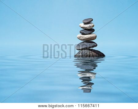 Zen meditation relaxation peacefulness peace of mind concept background -  balanced stones stack in water with reflection