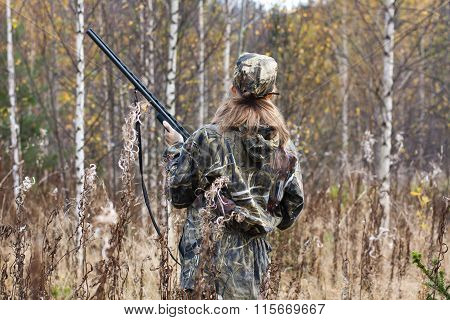 Woman Hunter With Gun Shooting In The Forest
