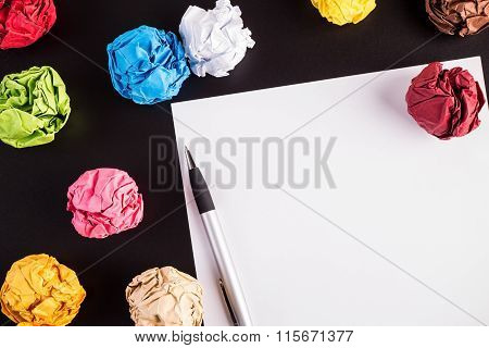 Creased Color Papers With White Paper And Ballpen
