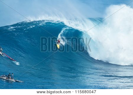 MAUI, HI - JANUARY 16 2016: Professional surfer Kai Lenny rides a giant wave at the legendary big wave surf break known as