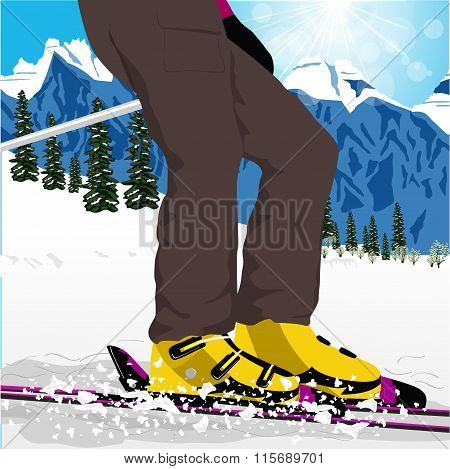 woman's legs in ski boots with spray of snow
