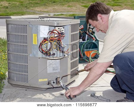 Checking Levels On Air Conditioning Unit