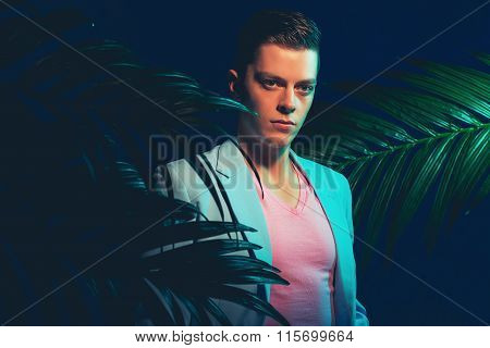 Stylish Gorgeous Young Man Between Palm Plants