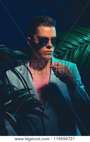 Handsome Man In Formal Suit Holding Cigarette
