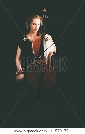 Pensive Lady Cellist Holding A Cello Instrument
