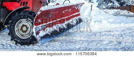 Big Snow Plow Truck On Snowy Road