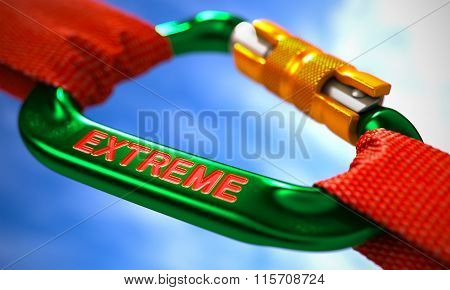 Extreme on Green Carabiner between Red Ropes.