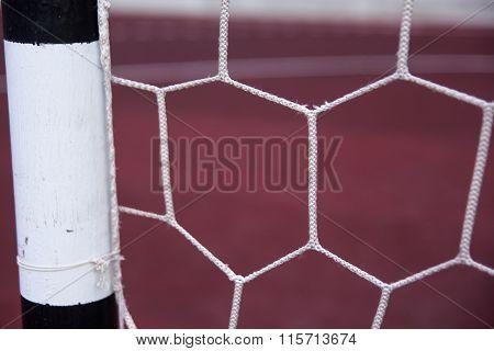 Soccer goal net on red background. Sport theme.