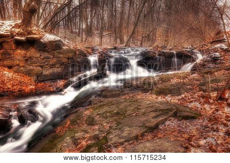 Cold Waterfall In Golden Forest
