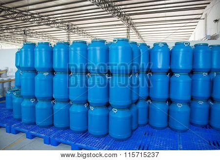 Blue Plastic barrels contain