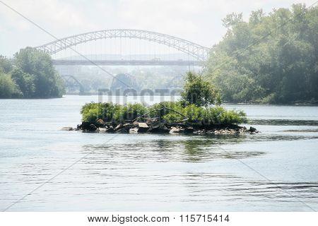 Small Island On River With Bridge