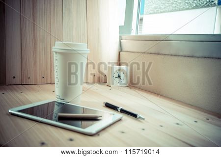 Clock On Table With  Coffee Cup And Shutdown Tablet, Relax Time