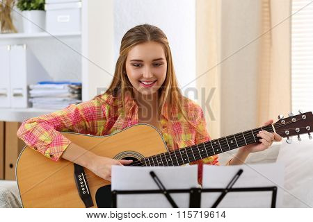 Beautiful Smiling Woman Holding And Playing Western Acoustic Guitar