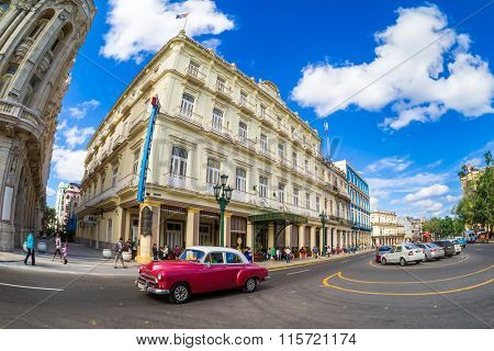 HAVANA,CUBA- JANUARY 19,2015 : Street scene with old classic car next to a famous hotel in Havana