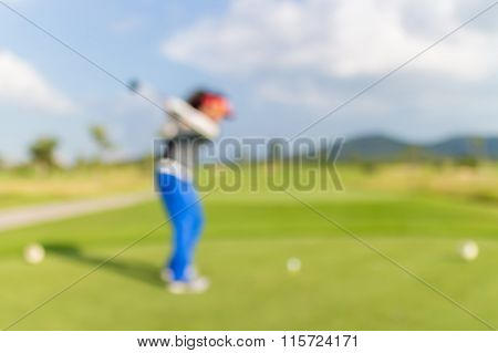 Blurred Photo Of Woman Golf Player On Green During Golf Match.