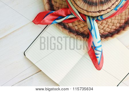 Straw summer hat and note book