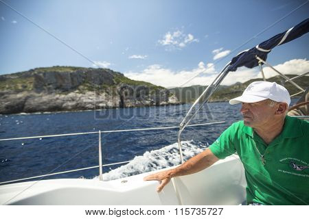 MONEMVASIA, GREECE - CIRCA MAY, 2014: Sailor participate in sailing regatta 11th Ellada 2014 Spring among Greek island group in the Aegean Sea, in Cyclades and Argo-Saronic Gulf.