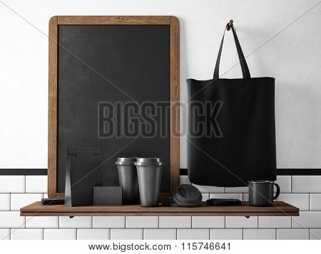 Black chalkboard on bookshelf with set of branding objects. 3d rendering