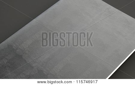 Closeup of leather cover on textbook, gray background. 3d render