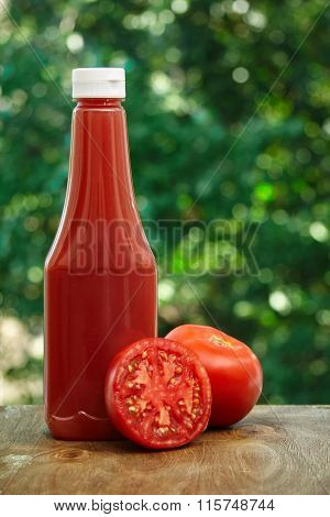 Tomato and bottle of ketchup