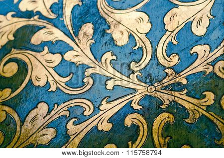 Gold Flourish Design. Blue Background