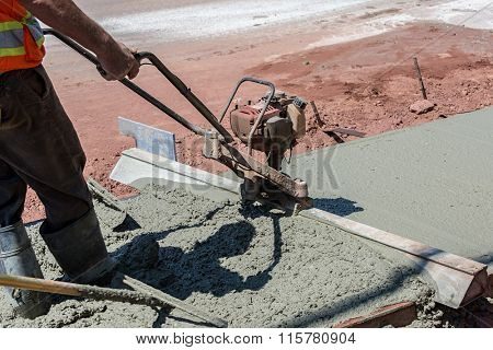 Construction process in the making of a freshly pored cement sidewalk.