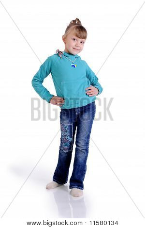 Charming Little Girl Standing In A Model Pose.