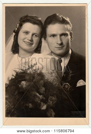 A vintage photo shows wedding portrait of newly-weds