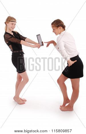Girl Holding The Tablet Pcs And The Other Girl Nazhymaye It