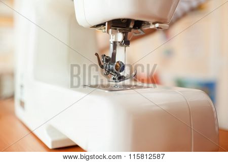 Sewing machine needle working part, detail and accessories, modern white, perspective.