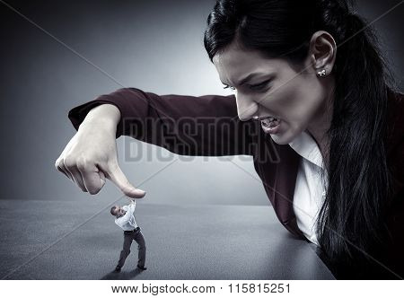 Lady boss crushing an employee under her thumb like a bug poster