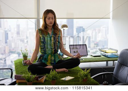 Business Woman Doing Yoga Meditation On Table In Office-2