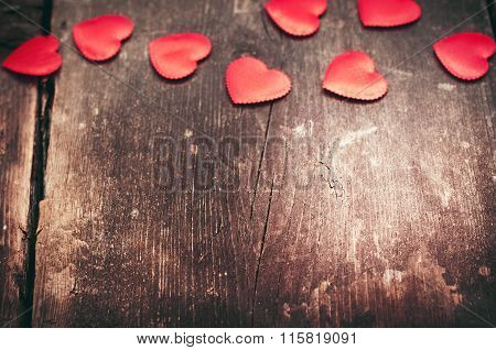 Red hearts on the old dark boards