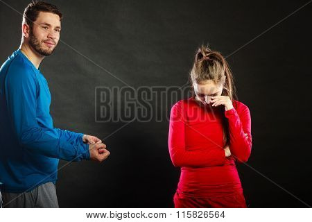 Man Husband Talking To Offended Woman Wife.