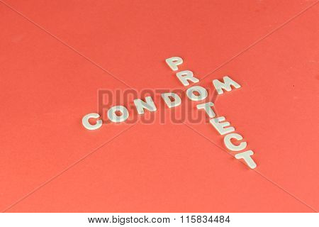 Condom And Protect Puzzle On Red Blood Background