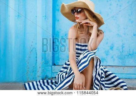 Summer portrait of a woman in a straw hat