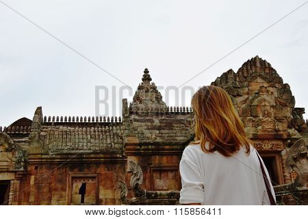 traveler on Phanom Rung stone castle in Thailand