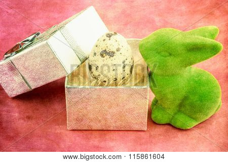 Green Easter bunny with quail egg in gift box