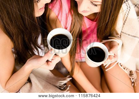 Two Girls With Cups Of Coffee In Hands,  Close Up Photo