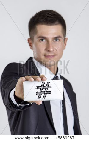 Hashmark # - Young Businessman Holding A White Card With Text