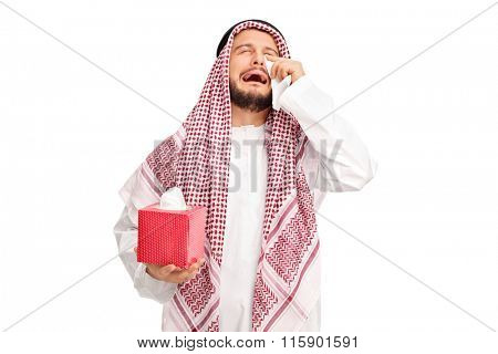 Sad young Arab crying and wiping his tears with wipes isolated on white background