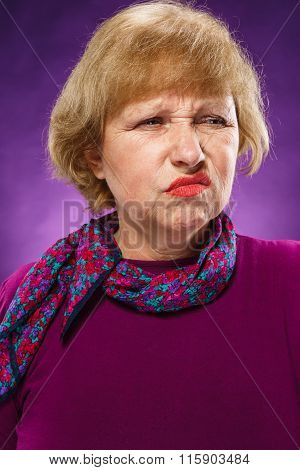The portrait of a disaffected senior woman