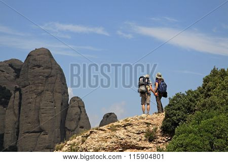 Montserrat, Spain - August 28, 2012: Tourists On Hiking Path In The Mountains Near Benedictine Abbey